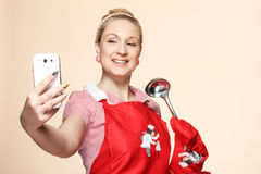 Baker woman shooting herself by phone. Studio picture Royalty Free Stock Images