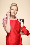 Baker woman speaking by phone Stock Images