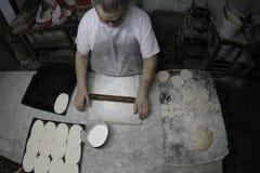 Baker at work Stock Image