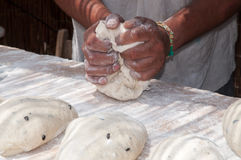 Baker. Worked in the dough for breads Stock Image