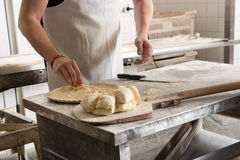 Baker working with dough Stock Photos