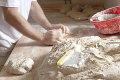 Baker Working with Dough. Royalty Free Stock Image