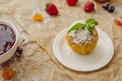 Bakered apple with powdered sugar on parchment background Stock Images