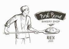 Bakerl烘烤了面包 库存照片