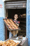 Bakerman showing his croissants. A bakerman at the door of his little bakery showing his croissants just made in Casablanca, Morocco Stock Photo