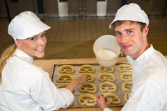 Bakers in bakery producing pretzels Stock Photos