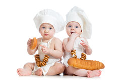 Bakers kids boy and girl. Bakers children boy and girl Royalty Free Stock Photos