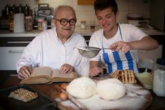 Bakers Knead Homemade Bread On A Wooden Table Stock Images