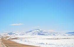 Bakers Peak In Winter. Blue Skies With Highway In Foreground Landscape stock photo