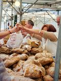 Bakers selling Hogazas, typical Spanish bread loaf. Stock Photo
