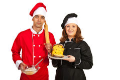 Bakers showing cake dough and cake Stock Photos