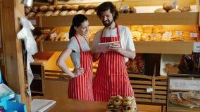 Bakers using digital tablet stock video footage