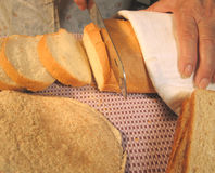 Bakery. Cutting bread Royalty Free Stock Photos