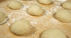 In the bakery. Dough for Pizza or little Bread Stock Photography