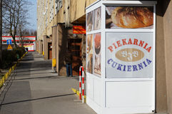 Bakery by apartment block Stock Image