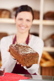 Bakery assistant selling bread Royalty Free Stock Images
