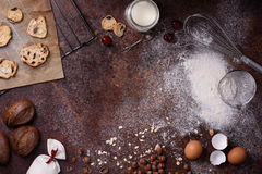 Bakery background, baking ingredients over rustic kitchen countertop. Baked cookies with hazelnuts, rye bread, milk and eggs. Top Stock Photos