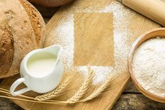 Bakery background with flour frame on board Royalty Free Stock Photo