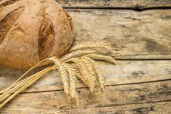 Bakery background. Fresh bread on wood table Royalty Free Stock Photos