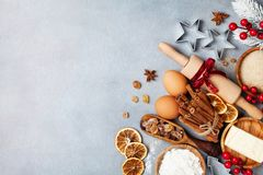 Bakery background with ingredients for cooking christmas baking decorated with fir tree. Flour, brown sugar, eggs and spices. stock images