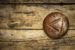 Bakery background with loaf of bread on wooden table Stock Images