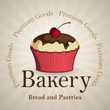 Bakery background with vanilla cupcake Stock Images