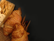 Bakery Bread of Fresh croissant on a Wooden Table. Royalty Free Stock Photo