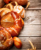 Bakery bread on a wooden table Stock Images