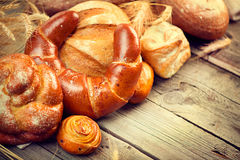 Bakery bread on a wooden table royalty free stock photos