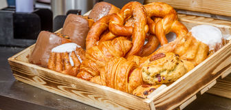Bakery Bread on a Wooden Table. Various Bread and Sheaf of Wheat Stock Photos