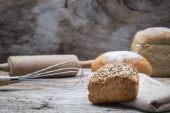 Bakery breads on a wooden table. Royalty Free Stock Image