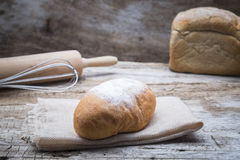 Bakery breads on a wooden table. Royalty Free Stock Images