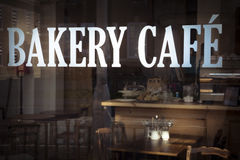 Bakery cafe sign in window of local business Stock Image