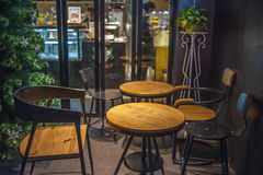 Bakery cafe tables and chairs outdoor Night Stock Photography