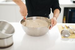 Bakery chef cooking bake in the kitchen professional Stock Photography