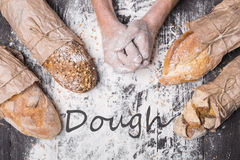 Bakery concept background. Hands and sorts of bread loaf Royalty Free Stock Images