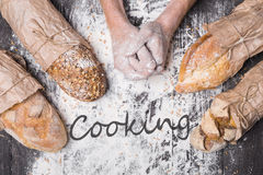 Bakery concept background. Hands and sorts of bread loaf Stock Image