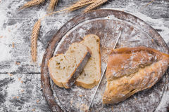 Bakery concept background. White sliced bread and knife Stock Photos