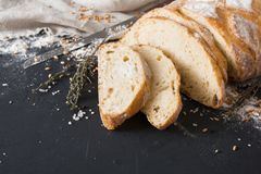 Bakery concept. Plenty of sliced bread background. Bakery background, sliced white bread on black. Flour and grain with copy space Stock Photos