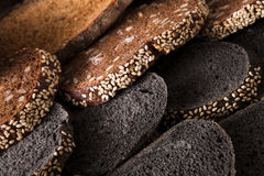 Bakery concept. Plenty of sliced bread background. Sliced black bread gradient background. Bakery and grocery concept. Fresh, healthy whole grain sliced sorts of royalty free stock photos