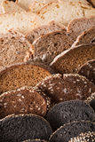 Bakery concept. Plenty of sliced bread background. Sliced black bread gradient background. Bakery and grocery concept. Fresh, healthy whole grain sliced sorts of stock photo