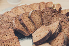 Bakery concept. Plenty of sliced bread background. Plenty of sliced bread background. Bakery or catering concept. Fresh, healthy whole grain sliced sorts of rye royalty free stock images