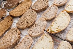 Bakery concept. Plenty of sliced bread background. Sliced bread gradient background. Bakery and grocery concept. Fresh, healthy whole grain sliced sorts of rye Stock Photography