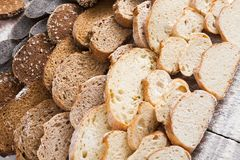 Bakery concept. Plenty of sliced bread background. Sliced bread gradient background. Bakery and grocery concept. Fresh, healthy whole grain sliced sorts of rye royalty free stock photo