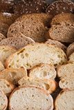 Bakery concept. Plenty of sliced bread background. Sliced bread gradient background. Bakery and grocery concept. Fresh, healthy whole grain sliced sorts of rye stock photos