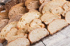 Bakery concept. Plenty of sliced bread background. Sliced bread gradient background. Bakery and grocery concept. Fresh, healthy whole grain sliced sorts of rye Stock Photo
