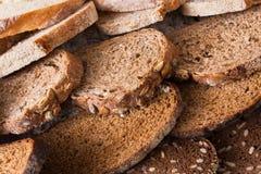 Bakery concept. Plenty of sliced bread background. Sliced bread gradient background. Bakery and grocery concept. Fresh, healthy whole grain sliced sorts of rye royalty free stock photos