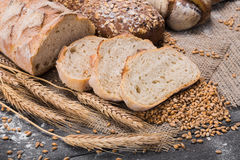Bakery concept. Plenty of sliced bread background. Plenty of sliced bread background. Bakery and grocery concept. Fresh, healthy sorts of rye and white loaves Royalty Free Stock Photography