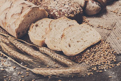 Bakery concept. Plenty of sliced bread background. Plenty of sliced bread background. Bakery and grocery concept. Fresh, healthy sorts of rye and white loaves Royalty Free Stock Images