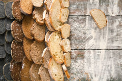 Bakery concept. Plenty of sliced bread background. Sliced sorts of bread gradient background. Bakery and grocery concept with copy space. Black, rye and white Royalty Free Stock Photos